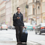 Man walking with a suitcase